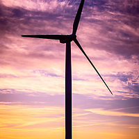 Wind Turbine picture on Wind Farm in Indiana. The power generating windwill is part of the Meadow Lake Wind Farm in Chalmers Indiana. Wind turbines are being a more popular source of renewable and alternative energy for energy conservation. Picture is high resolution and was taken during sunrise in 2013.