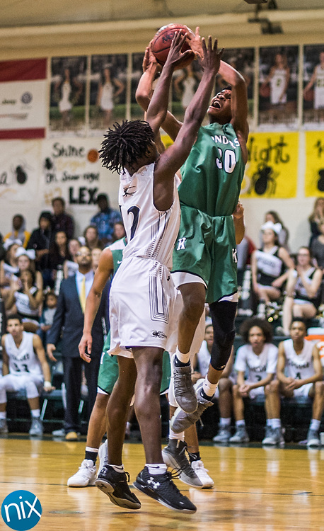 Kannapolis' Amari Grier (20) goes up for a shot against Concord during a South Piedmont Conference basketball game Saturday night at Central Cabarrus High School.