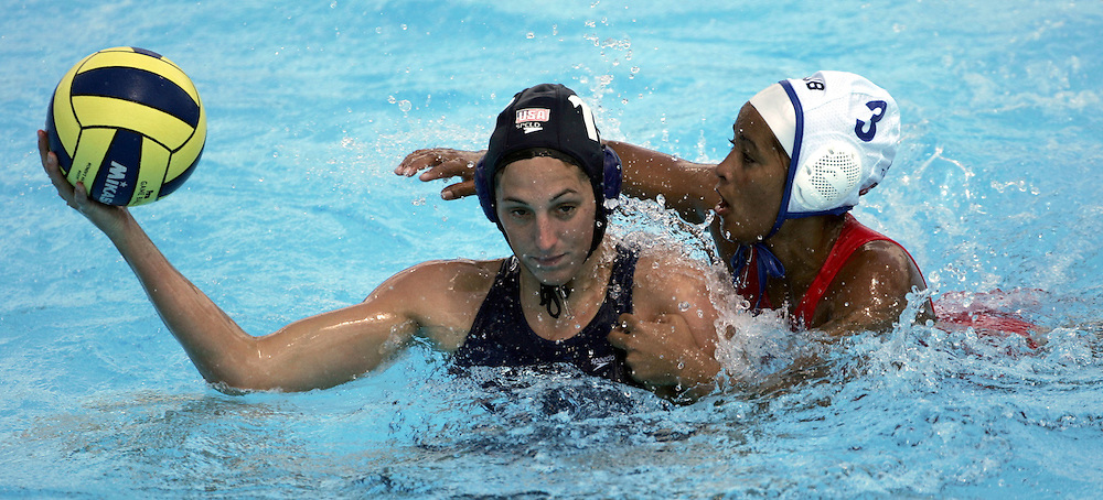 USA's Thalia Munro (L) tries to keep the ball away from Cuba's Yanaisi Perez (R) during their preliminary round women's water polo competition against Italy at the FINA World Championships in Montreal, Quebec Saturday 24 July 2005. Italy defeated Spain 9-6. USA defeated Cuba 14-3.