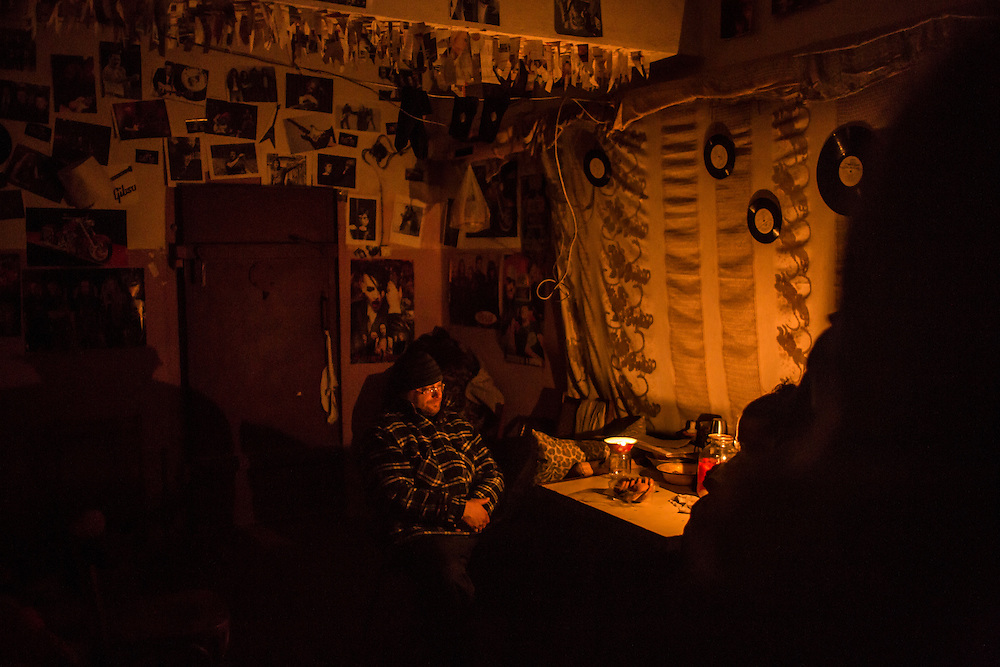 MYRONIVSKYI, UKRAINE - FEBRUARY 17: A man sits inside a bomb shelter at the local House of Culture on February 17, 2015 in Myronivskyi, Ukraine. A ceasefire agreed to by Ukraine and pro-Russian rebel forces has failed to prevent fighting in the nearby town of Debaltseve, where thousands of Ukrainian troops remain and whom rebels claim to have surrounded. (Photo by Brendan Hoffman/Getty Images) *** Local Caption ***