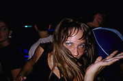 Girl wearing coloured contact lenses in a club, Sao Paolo, Brazil, 2000's