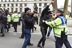 In Whitehall a Metropolitan Police officer physically prevents an anti-fascist protestor from attacking members of Pegida (Patriotic Europeans Against the Islamisation of the West), London Feb 2016