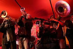 Dec 03 2007. New Orleans, Louisiana. Lower 9th Ward.<br /> Brad Pitt revisits the Lower 9th ward, devastated by Hurricane Katrina to present 'Make it Right' where architects' designs are unveiled to the public. Rebirth Brass Band play at the evening concert.<br /> Photo credit; Charlie Varley.