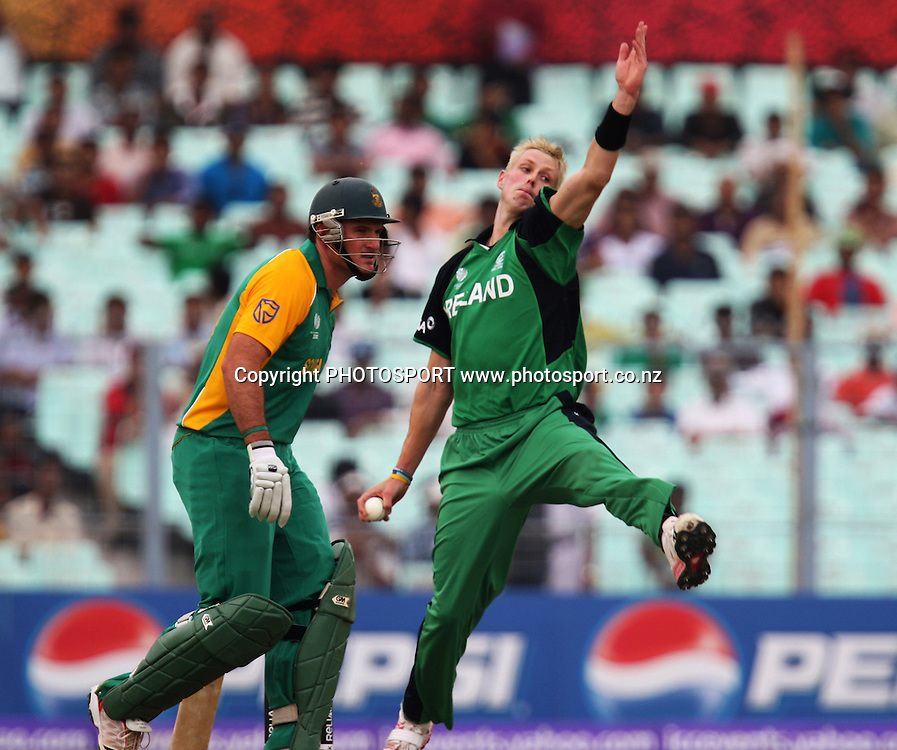 Ireland bowler Boyd Rankin in bowling action against Southa African batsman Hashim Amla during the ICC Cricket World Cup - 34th Match, Group B South Africa vs Ireland Played at Eden Gardens, Kolkata, 15 March 2011 - day/night<br /> (50-over match)