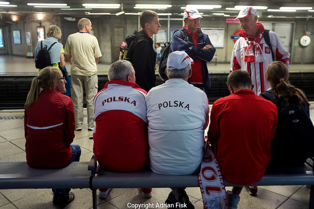 Polish Olympic fans wait for a London underground train to arrive