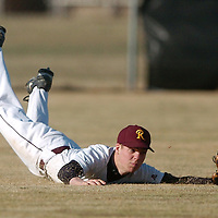 Redmond's Cody Bulkley (1) dives to catch a shallow fly ball hit to right field during the sixth inning against Mountain View Friday..