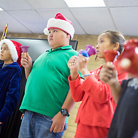 121814       Cable Hoover<br /> <br /> Caleb Lohmin, left, Matthew Brown, Jared Dixon, Latasha Cadman and other Churchrock Academy students perform with handbells Thursday at the Ford Canyon Senior Center in Gallup.