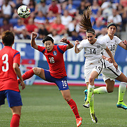 Morgan Brian, (left), Korean Republic and Morgan Brian, U.S. Women's National Team, challenge for the ball during the U.S. Women's National Team Vs Korean Republic, International Soccer Friendly in preparation for the FIFA Women's World Cup Canada 2015. Red Bull Arena, Harrison, New Jersey. USA. 30th May 2015. Photo Tim Clayton