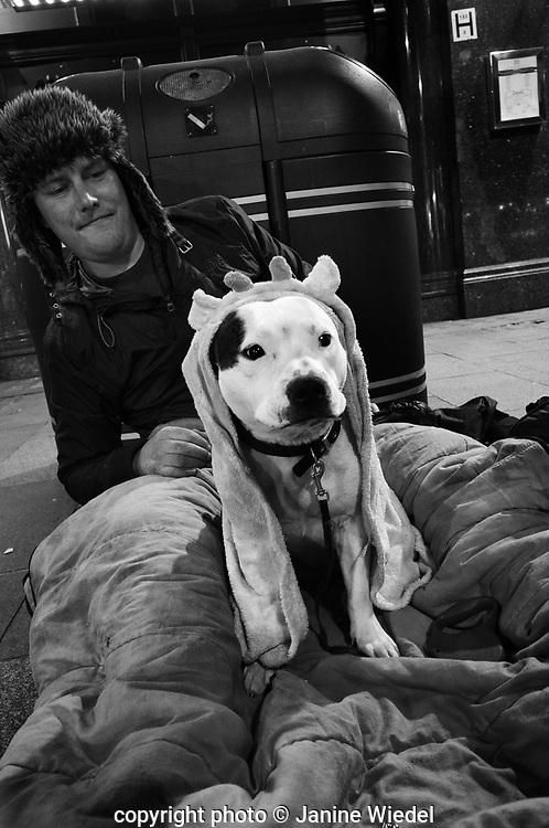 Homeless man in Soho with hia dog.