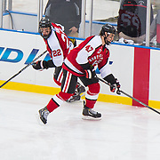 Dustin Darou #47 of the Northeastern Huskies and Tanner Pond #22 of the Northeastern Huskies in action during the Frozen Fenway game between The Northeastern Huskies and The UMass Lowell Riverhawks at Fenway Park on January 11, 2014 in Boston, Massachusetts.