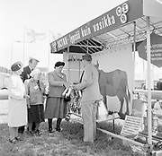 Agricultural show Finland, 1950s man holding milking equipment