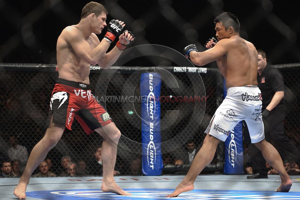 "LONDON, ENGLAND, OCTOBER 2010: Michael Bisping (left) and Yoshihiro Akiyama face off during ""UFC 120: Bisping vs. Akiyama"" inside the O2 Arena in Greenwich, London"