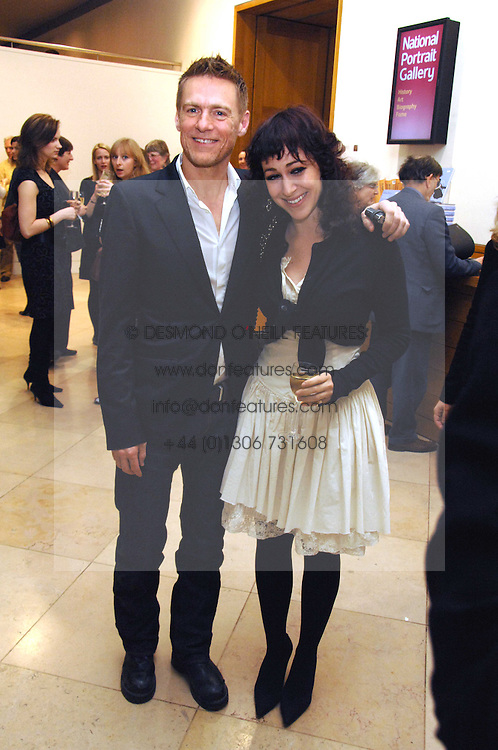 BRYAN ADAMS and ANNIE MORRIS at a private view of Bryan Adam's photographs entitled 'Modern Muses' held at The National Portrait Gallery, London on 11th March 2008.<br /><br />NON EXCLUSIVE - WORLD RIGHTS