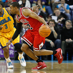 February 12, 2011; New Orleans, LA, USA; Chicago Bulls point guard C.J. Watson (32) drives past New Orleans Hornets point guard Chris Paul (3)  during the second quarter at the New Orleans Arena.   Mandatory Credit: Derick E. Hingle