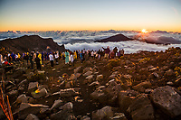 A large group of people watching the sun rise atop Haleakala Volcano on Maui, Hawaii