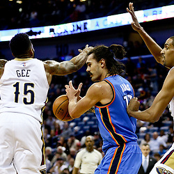 Feb 25, 2016; New Orleans, LA, USA; Oklahoma City Thunder center Steven Adams (12) is defended by New Orleans Pelicans forward Alonzo Gee (15) and center Alexis Ajinca (42) during the first quarter of a game at Smoothie King Center. Mandatory Credit: Derick E. Hingle-USA TODAY Sports