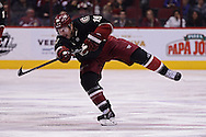 Nov 5, 2013; Glendale, AZ, USA; Phoenix Coyotes forward Shane Doan (19) in action against the Vancouver Canucks at Jobing.com Arena. The Coyotes defeated the Canucks 3-2 in an overtime shoot out. Mandatory Credit: Jennifer Stewart-USA TODAY Sports