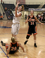 Fairmont's Cassie Sant (42) and Beavercreek's Kelsie Cooley (31) watch the ball at the basket as the Beavercreek Lady Beavers take on Kettering's Fairmont High School Lady Firebirds Wednesday night, January 31, 2007.
