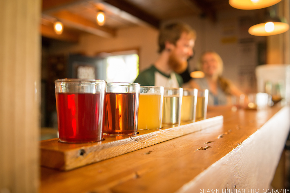 Ali Smith and Chad Usby enjoy a flight of ciders at Reverend Nat's taproom in Portland, Oregon.