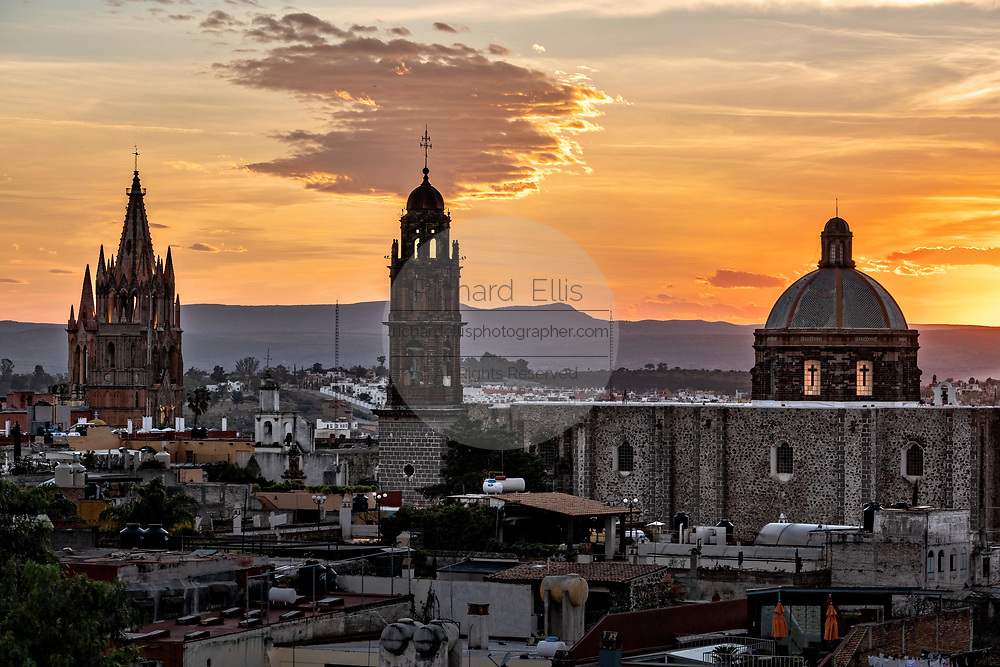Sunset over the iconic churches in the historic center of San Miguel de Allende, Guanajuato, Mexico. The Parroquia de San Miguel Arcangel, left, San Francisco church, right.