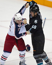 October 8, 2009; San Jose, CA, USA; San Jose Sharks left wing Frazer McLaren (68) and Columbus Blue Jackets right wing Derek Dorsett (15) fight during the second period at HP Pavilion.  San Jose won 6-3. Mandatory Credit: Jason O. Watson / US PRESSWIRE