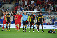 James Collins of Wales (5) is sent off after a bad tackle on Belgium's Guillaume Gillet (on ground) . World cup 2014 qualifying match, Group A, Wales v Belgium at the Cardiff city stadium in Cardiff, South Wales on Friday 7th Sept 2012.  pic by  Andrew Orchard, Andrew Orchard sports photography,