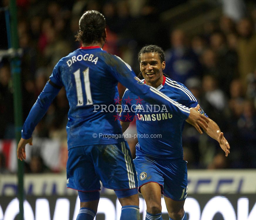 BOLTON, ENGLAND - Monday, January 24, 2011: Chelsea's Florent Malouda celebrates scoring the second goal against Bolton Wanderers with team-mate a fellow scorer Didier Drogba during the Premiership match at the Reebok Stadium. (Photo by David Rawcliffe/Propaganda)