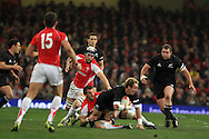 Jimmy Cowan of New Zealand is stopped by Sam Warburton of Wales. Invesco Perpetual match, Wales v New Zealand at the Millennium stadium in Cardiff on Sat 27th Nov 2010.  pic by Andrew Orchard, Andrew Orchard sports photography,
