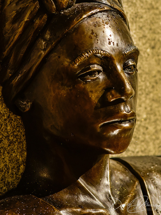 Detail of female figure at north end of the memorial taken at night shortly after a rain shower