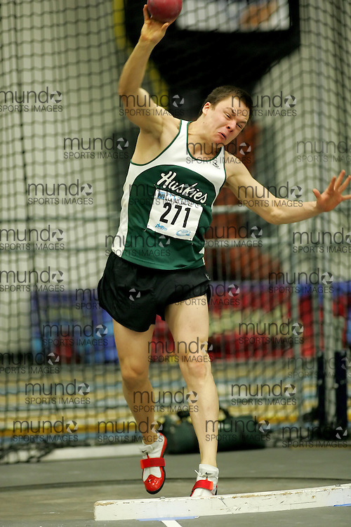 (Windsor, Ontario---11 March 2010) Evan Neufeldt of University of Saskatchewan competes in the  competes in the pentathlon shot put at the 2010 Canadian Interuniversity Sport Track and Field Championships at the St. Denis Center. Photograph copyright Sean Burges/Mundo Sport Images. www.mundosportimages.com