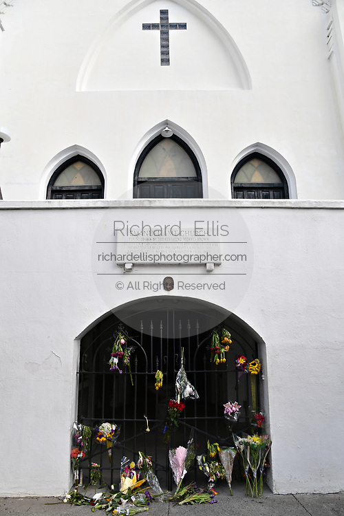 Floral bouquets on the gate at the historic Mother Emanuel African Methodist Episcopal Church on the 4th anniversary of the mass shooting June 17, 2019 in Charleston, South Carolina. Nine members of the historically black congregation were gunned down during bible study by a white supremacist on June 17, 2015.