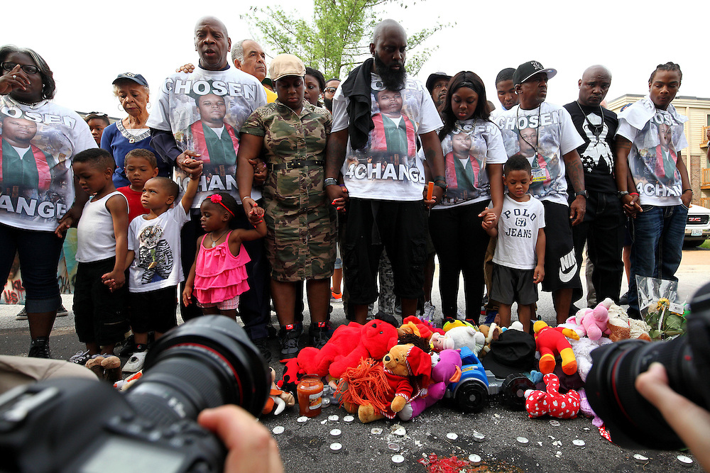 MICHAEL BROWN SR., father of Mike Brown Jr., stands with his family at the memorial (decorated with toys and stuffed animals) of Mike Brown Jr. Sunday marks the one year anniversary of the death of Mike Brown Jr., killed by Officer Darren Wilson in Ferguson.