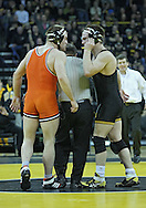 January 07, 2011: Oklahoma State's Chris Perry and Iowa's Ethen Lofthouse have words after the 174-pound bout in the NCAA wrestling dual between the Oklahoma State Cowboys and the Iowa Hawkeyes at Carver-Hawkeye Arena in Iowa City, Iowa on Saturday, January 7, 2012. Perry won 3-2.