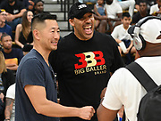 Former Chino Hills head basketball coach Steve Baik (left) laughs with LaVar Ball (right) during a Drew League basketball game, Saturday, June 8, 2019, in Los Angeles.  (Dylan Stewart/Image of Sport)