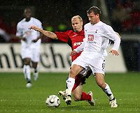 Photo: Paul Thomas.<br /> Bayer Leverkusen v Tottenham Hotspur. UEFA Cup. 23/11/2006.<br /> <br /> Teemu Taino (R) of Spurs gets tackled by Sergej Barbarez.