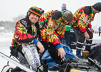 """""""Time to play some hockey, Mon"""" with Brian Hogan and his team The Puck Monkeys as they lace up for their 35+ Shinny division game with the Reggie Dunlop team on day one of the New England Pond Hockey Classic on Lake Waukewan Friday.  (Karen Bobotas/for the Laconia Daily Sun)"""