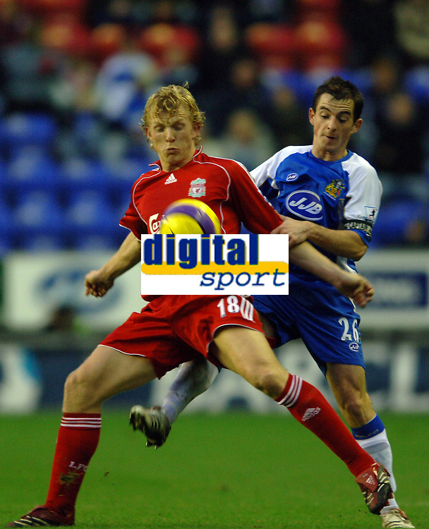 Photo: Paul Greenwood.<br />Wigan Athletic v Liverpool. The Barclays Premiership. 02/12/2006. Liverpool's Dirk Kuyt, left, beats Wigan's Leighton Baines to the ball