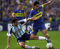 29/08/04 – BOCA JUNIORS (2) Vs. RACING (1) - Football - Bs.As. - Argentina. Fourth match of the Torneo Apertura 2004. <br />FRANCO CANGELE (BOCA) AND LEONARDO TAMBUSSI (RACING).<br />©Argenpress.com