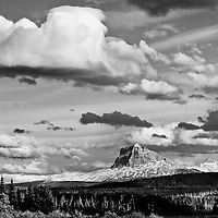 chief  mountain under billowing clouds  glacier national park waterton international piece park