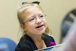 """Erica Rasche attended a speech therapy session with Maddie Marshall at Southern Indiana Rehabilitation Hospital New Albany, Thursday, Feb. 11, 2016 <br /> <br /> 9 year old, Erika Rasche was diagnosed with a chromosome 9 deletion, also known as 9p Deletion Syndrome, a rare genetic condition that can cause a variety of physical abnormalities and developmental delays. Doctors also detected an intestinal malrotation, where Erika's intestine had failed to coil into the proper position in her abdomen. She underwent surgery to correct it.<br /> <br /> She came home from the hospital very frail about a month later — on oxygen and a feeding tube. Less than a week after that, she had to be admitted to Kosair in Louisville because her vomiting and other symptoms had worsened. There, she had to undergo open-heart surgery to correct a hole in her heart. <br /> <br /> She was finally able to return home before her first birthday to begin her recovery and start therapy. Though her heart is now """"fine,"""" according to her mom, Erika has had continued problems with movement, speech and swallowing that required long-term therapy."""