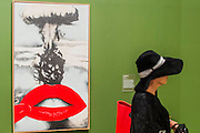 Atomic Kiss 1968 by Joan Rabascall - The EY Exhibition: The World Goes Pop, opens at the Tate Modern. The exhibition covers the full breadth of international Pop Art from the 1960s and 70s, 'exploding' the traditional story of Pop. The show features 'colourful and exciting' works from Latin America, Asia, Europe and the Middle East – the majority of which have never before been shown in the UK. Highlights include: Japanese pop artist Tajiri's striking large scale sculpture Machine No.7, surrounded by works by artists Ushio Shinohara, Erro, Equipo Cronica and Evelyne Axel; a mirrored full room installation specially recreated for this exhibition by Polish pop artist Jana Zelibska; and Henri Cueco's multi-layered sculptural work Large Protest 1969 seen in front of his painting The Red Men, bas-relief 1969, exploring the Cold War, Vietnam War and May 1968 protests in Paris. The Exhibition is at Tate Modern from 7 September 2015 - 24 January 2015.