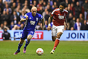 Birmingham City midfielder David Cotterill (11)  holds off Nottingham Forest defender Armand Traore (6) during the EFL Sky Bet Championship match between Nottingham Forest and Birmingham City at the City Ground, Nottingham, England on 14 October 2016. Photo by Jon Hobley.