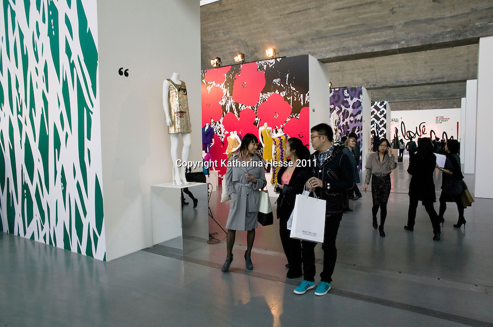 """Beijing, April,2, 2011 : visitors look at art work displayed at the """" Journey of a Dress """" exhibition in Beijing."""