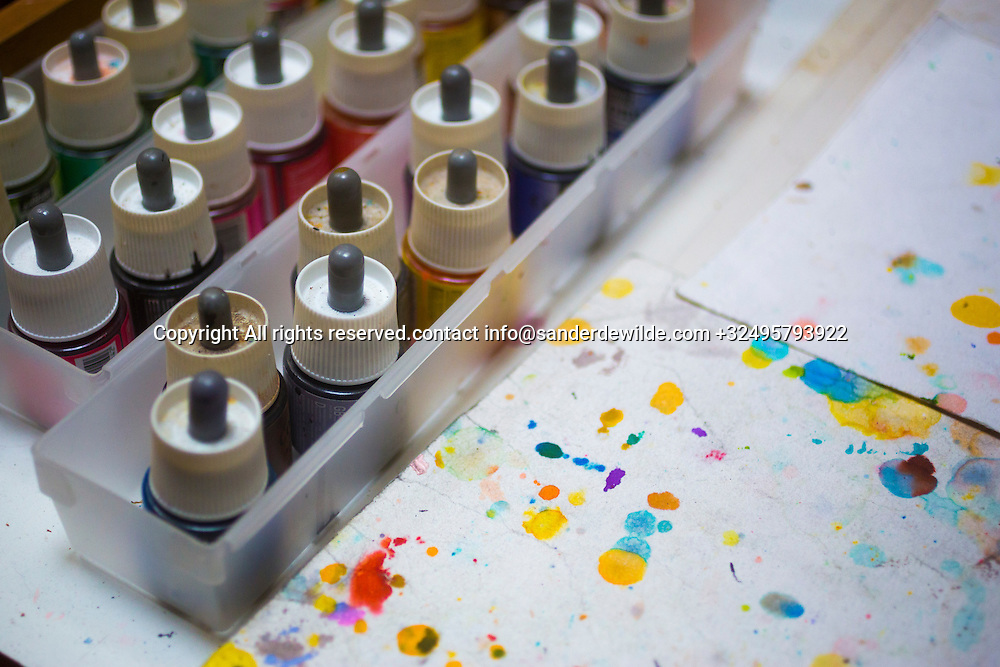 Brussels, Belgium 29 August 2014. colorful ink bottles and spatters of Johan De Moor, famous Belgian cartoonist and son of Bob De Moor, right hand of Tintin's Hergé in his studio. © Sander de Wilde pour M le magazine du Monde