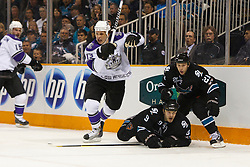 April 14, 2011; San Jose, CA, USA;  San Jose Sharks defenseman Ian White (9) is knocked to the ice in front of center Scott Nichol (21) and Los Angeles Kings left wing Kyle Clifford (13) during the first period at HP Pavilion. San Jose defeated Los Angeles 3-2 in overtime. Mandatory Credit: Jason O. Watson / US PRESSWIRE