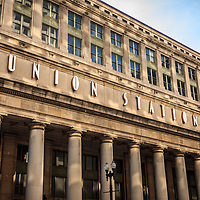 Chicago Union Station building exterior sign and pillars. Union Station opened in 1925 and serves as a train station for commuter trains.