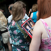 May 26, 2012 - New York, NY :  Fans of pop group 'One Direction' wait outside the VIP entrance on Amsterdam Avenue at the Beacon theater in Manhattan on  Saturday afternoon. The group is on the road for their first-ever headlining North American tour in support of their debut album UP ALL NIGHT. CREDIT: Karsten Moran for The New York Times