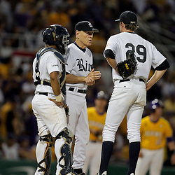 05 June 2009:  Rice head coach Wayne Graham talks with pitcher Matthew Reckling (29) on the mound during a 12-9 victory by the LSU Tigers over the Rice Owls in game one of the NCAA baseball College World Series, Super Regional played at Alex Box Stadium in Baton Rouge, Louisiana.