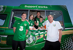 Three joins forces with Shane Long, Stephen Ward and Richard Dunne to celebrate the cream of supporters events, Three on the Quay ..Thursday 24th May 2012 - Three, Ireland's largest high speed network and proud supporters of the Irish football team, has teamed up with Republic of Ireland footballers; Stephen Ward, Shane Long and Richard Dunne pictured with Seren Evans (age 5) from East Wall and Cillian Farrell (age 5)from Clontarf to celebrate Three on the Quay and call on the people of Ireland to show their support for the team at three free festival style events for supporters at George's Dock on the 10th, 14th and 18th June. The players are pictured presenting Eva Norton (age 2) and her mother Francis with some green ice cream..Pic Andres Poveda CPR.- ENDS -