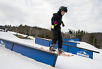 Gavin Makely gets some air time on the rails and boxes at Gunstock Mountain with the Gunstock Freestyle Academy on Sunday morning.  (Karen Bobotas/for the Laconia Daily Sun)